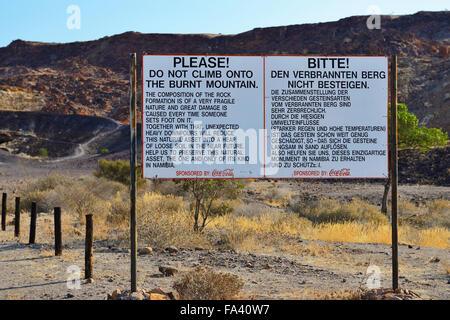 Sign at Burnt Mountain near Twyfelfontein, Damaraland, Namibia - Stock Photo