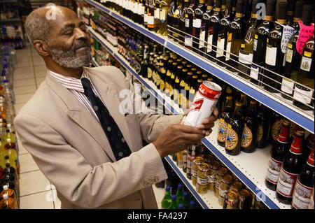 Man at his local shop; East Midlands Supermarket; Nottingham, - Stock Photo