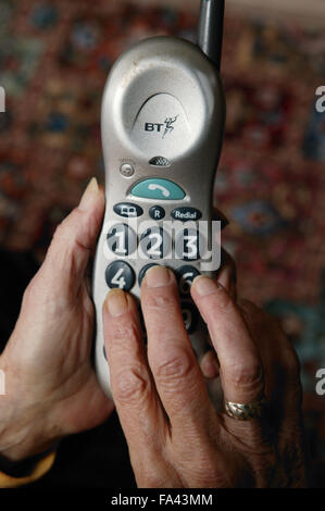 Close up of large numbered telephone to make dialling easier for visually impaired person, - Stock Photo