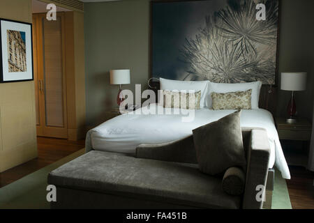 Bedroom in the luxurious Sofitel Hotel in the city of Bangkok in Thailand. - Stock Photo