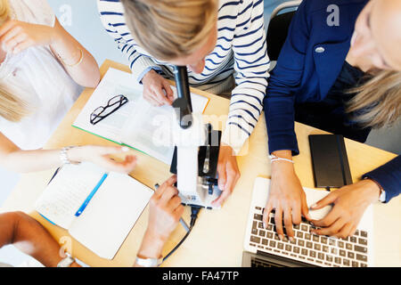 High angle view of students in science classroom - Stock Photo