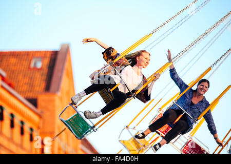 Young woman on fairground ride. - Stock Photo