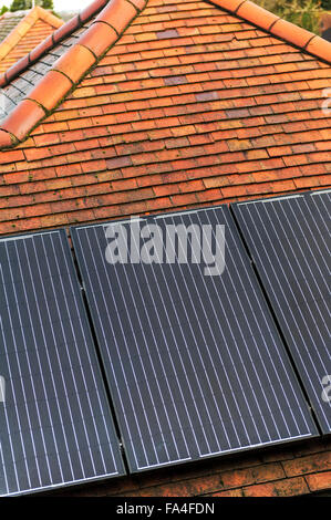 Solar roof panels on the roof of an urban bungalow. - Stock Photo
