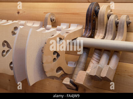 Frankfurt Oder, Germany. 17th Dec, 2015. A wooden bridges and pegboxes for contrabasses are on display at the workshop - Stock Photo
