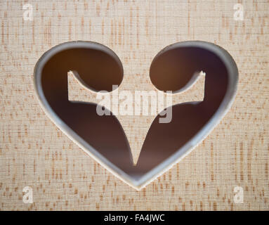 Frankfurt Oder, Germany. 17th Dec, 2015. A heart-shaped cut-out decorates the birdsge of a contrabass at the workshop - Stock Photo