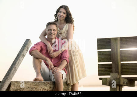 Portrait of mature couple smiling on pier, Bavaria, Germany - Stock Photo
