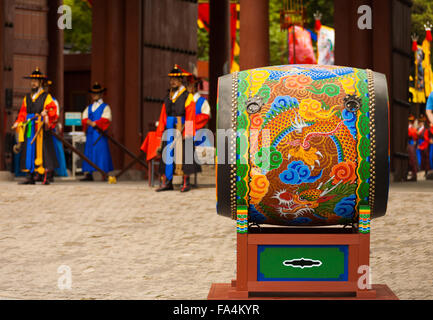 Large traditional Korean painted drum resting at entrance to Deoksugung Palace for the changing of the guards ceremony - Stock Photo