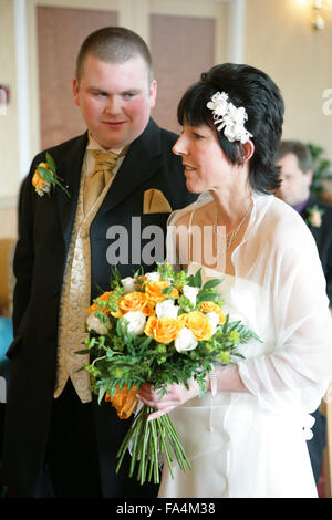 Bride and groom taking marriage vows at a registry office wedding, - Stock Photo