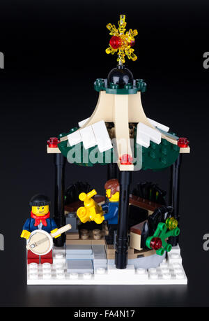 Tambov, Russian Federation - January 08, 2014 Two Lego musicians in Christmas pavilion on black background. Studio - Stock Photo