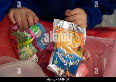 Food packets from school child's lunch box, - Stock Photo