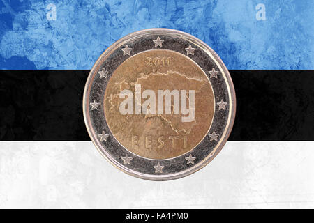 Two euros coin from Estonia isolated on the national estonian flag as background - Stock Photo