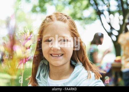 Portrait of a girl smiling, Munich, Bavaria, Germany - Stock Photo