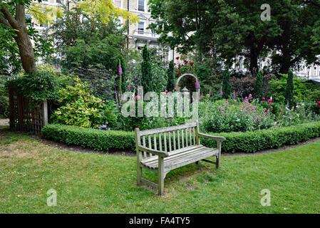 Bench, Queen's Gate Gardens South Kensington London SW7 England Britain UK - Stock Photo