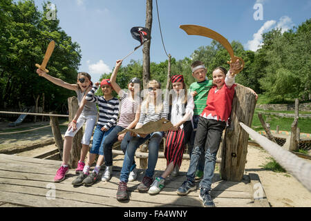 Group of children playing on a pirate ship in adventure playground, Bavaria, Germany - Stock Photo