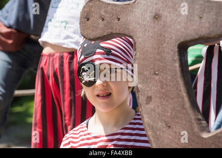 Boy dressed up as pirate in playground, Bavaria, Germany - Stock Photo