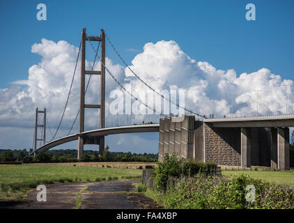 Towering cumulonimbus clouds provide a brilliant and dramatic backdrop to Humber Bridge - Stock Photo