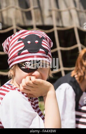 Portrait of a boy dressed up as a pirate in adventure playground, Bavaria, Germany - Stock Photo