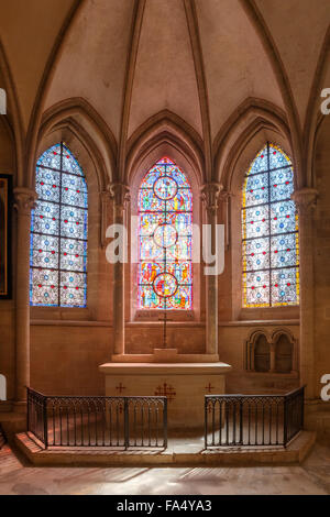 Catholic chapel with altar and stained glass in enchanting play of light, in the Coutances Cathedral in Normandy, - Stock Photo