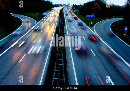 cars on highway Autobahn in Germany in high speed at night - Stock Photo