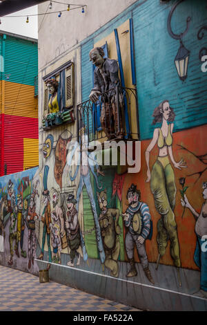 Side street with colourful graffiti art in La Boca, Buenos Aires, Argentina - Stock Photo