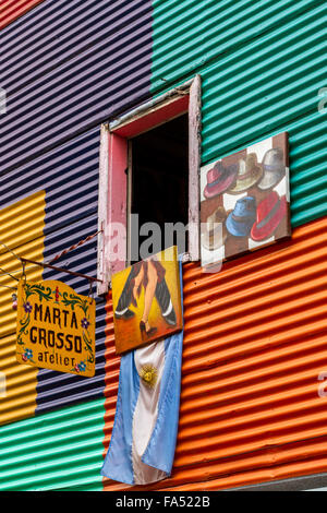 Window of a vibrant corrugated house and artist's workshop in La Boca, Buenos Aires, Argentina - Stock Photo