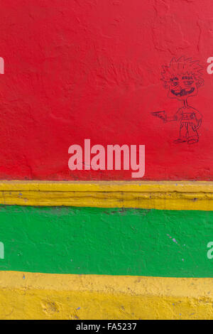 Graffiti on a brighly coloured wall in La Boca, Buenos Aires, Argentina - Stock Photo