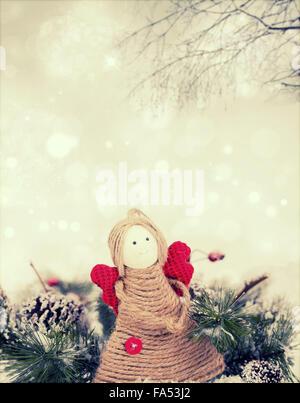 Vintage Christmas decoration with handmade angel figurine - Stock Photo