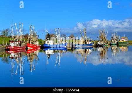 Shrimp boats in harbour, Greetsiel, Lower Saxony, Germany - Stock Photo