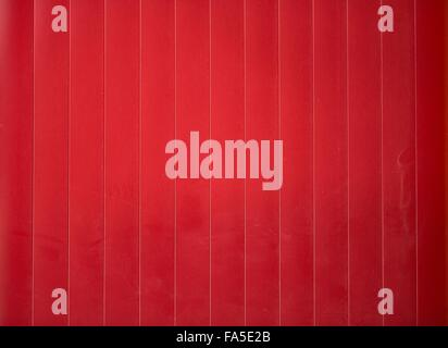 red shining metal fence in the shadow - Stock Photo
