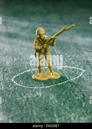 close up of the toys,plastic army on the green background - Stock Photo