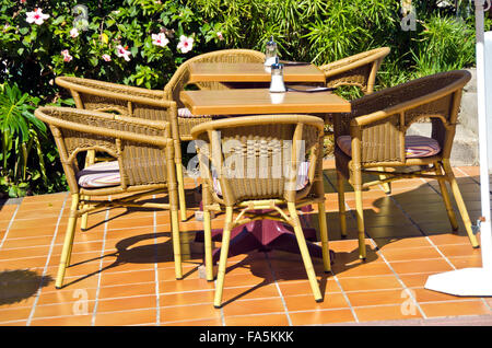 Chairs and tables in outdoors caffe on sunny summer day - Stock Photo