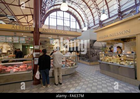 Food stalls inside the Saluhallen central market, Kungstorget, Gothenburg, West Gothland, Sweden, Europe - Stock Photo