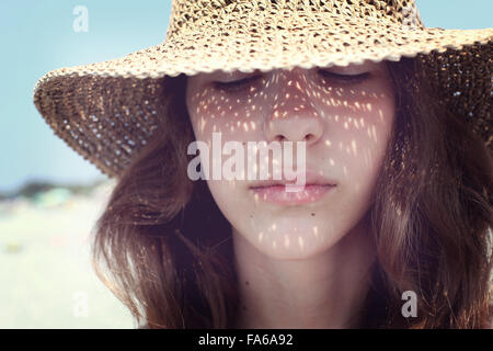 Portrait of a teenage girl wearing a straw hat, Condofuri, Calabria, Italy - Stock Photo
