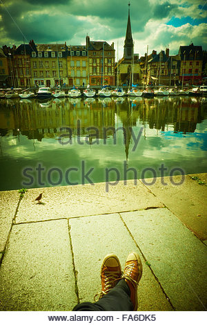 Honfleur, France, harbour. Summer dreaming by the Vieux Bassin harbor, Quiet moments of relaxation in another world - Stock Photo