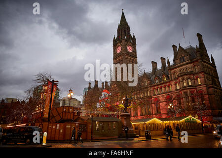 Manchester German Christmas Markets on Albert Square in front of the landmark Town Hall   Markets place training - Stock Photo