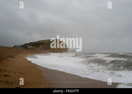 West Bay UK Weather 22nd December 2015 Strong winds and big waves on West bay beach Credit:  Paul Chambers/Alamy - Stock Photo