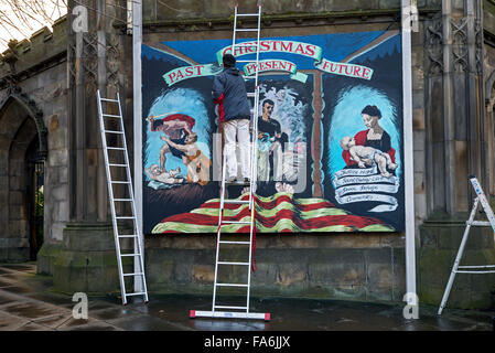 Christmas mural being painted at St John's Church at the West End of Princes Street, Edinburgh, Scotland, UK. - Stock Photo