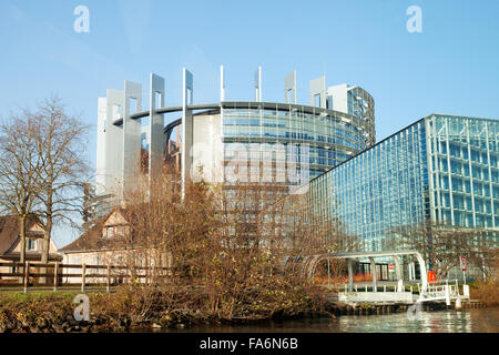 The European Parliament building in winter, seen from the River Ill, Strasbourg France Europe - Stock Photo