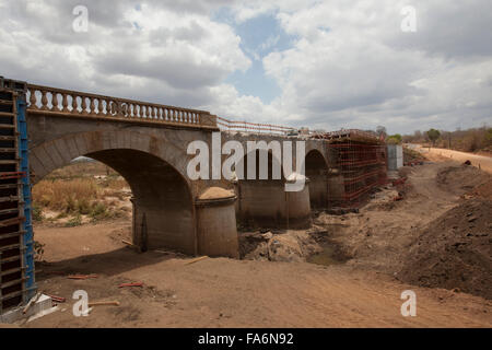 Construction workers rehabilitate an aging bridge along the Namialo to Rio Lurio Road in Northern Mozambique, SE - Stock Photo