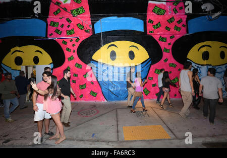 People tour art galleries in the Wynwood Arts District during Art Basel Miami.  (Photo by Sean Drakes/Alamy) - Stock Photo