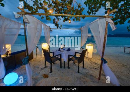 Romantic table by the sea on Koh Samui island, Thailand - Stock Photo