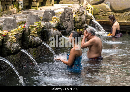 bathing structure with holy spring water of the Hindu water temple Tirta Empul near Ubud, Bali, Indonesia - Stock Photo