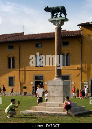 Statue of Romulus and Remus suckling on the wolf in the Plaza of Miracles, Pisa - Stock Photo