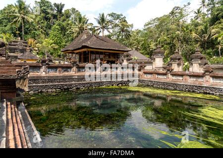 holy spring of the Hindu water temple Tirta Empul near Ubud, Bali, Indonesia - Stock Photo