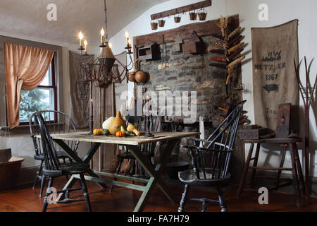 early american dining room table and chairs. dining room table and chairs in early american primitive style - stock photo