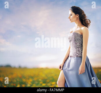 Pretty woman on the summer wheat field - Stock Photo