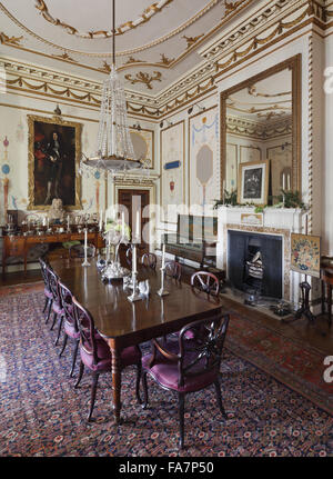 the dining room at hatchlands park, surrey. the painting at the