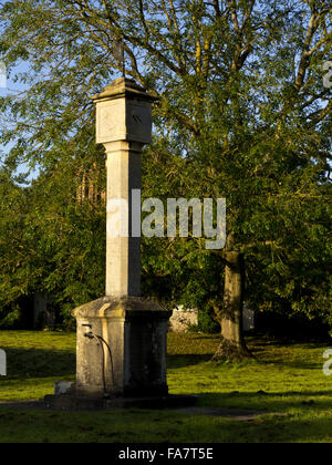 The sundial clock tower on the green at Blaise Hamlet in Bristol. The nine cottages around the green at Blaise Hamlet - Stock Photo