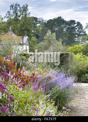 Herbaceous border in late summer in Bodnant Garden, Conwy, Wales. A border tumbles with September colour, with the - Stock Photo