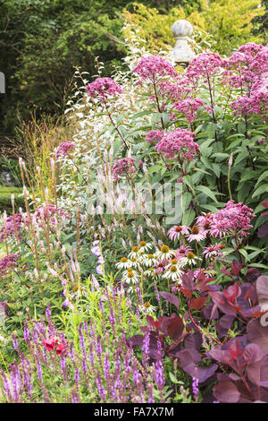 A late summer (September) border at Bodnant Garden, Conwy, Wales. Colour is provided by flowering perennials including - Stock Photo